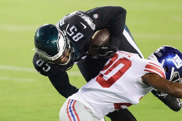 Richard Rodgers, shown muscling through Julian Love, was a key to the Eagles' victory Thursday, and figures to remain an important element of the passing game.