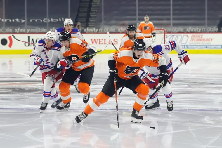 Flyers winger Joel Farabee skates with the puck against the New York Rangers on Thursday. Farabee's late goal in regulation helped the Flyers salvage a point in a 3-2 shootout loss.