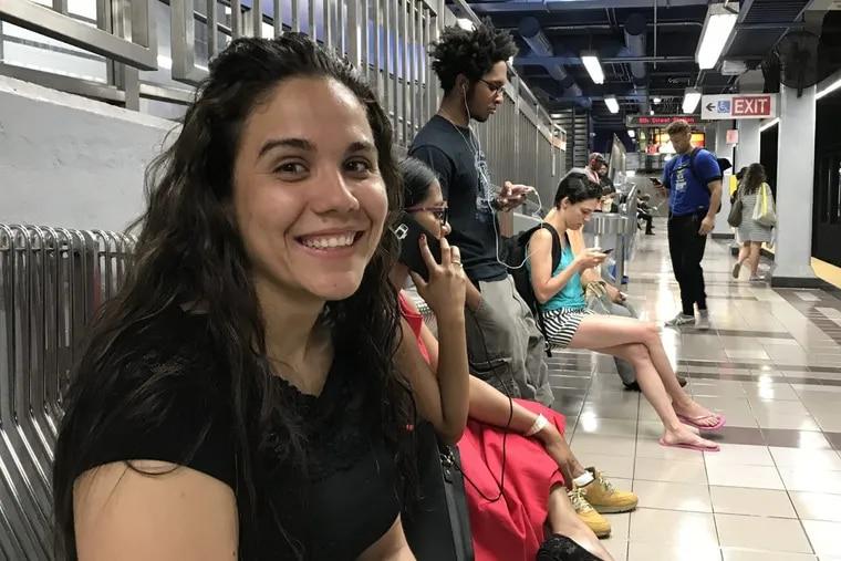 Elizabeth Rosario waits on the El at 8th and Market streets.