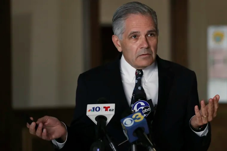 Philadelphia District Attorney Larry Krasner speaks during a news conference in July about the arrest of a police officer.