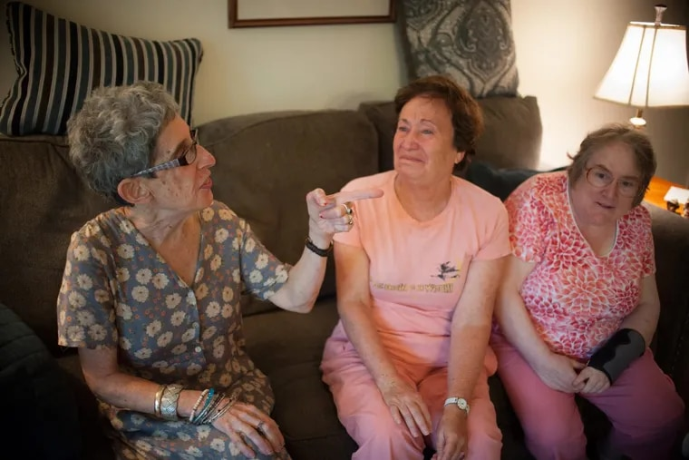 Harriet, 62, Phyllis, 70, and Debby, 50, chat in Harriet's living room.