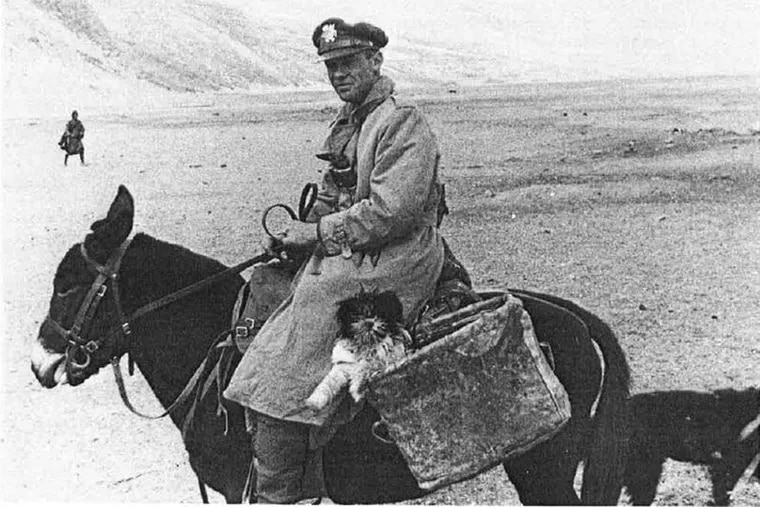 Brooke Dolan riding with his Lhasa apso in eastern Tibet, April 1943.