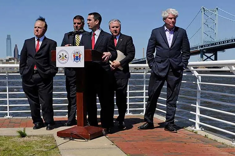 """Pennsylvania and New Jersey legislators team up on the Camden Delaware River Waterfront for a news conference Thursday to propose sweeping changes to the federal charter of the Delaware River Port Authority, to make it more accountable and transparent. At the microphone is Pa. Auditor General Eugene DePasquale. Behind him, from left are, N.J. Sen. Joe Pennacchio; Pa. Rep. Mike Vereb; Pa. Sen. John Rafferty, chairman of the Pa. Senate Transportation Committee; and Philadelphia union leader and DRPA board member John """"Johnny Doc"""" Dougherty Jr."""