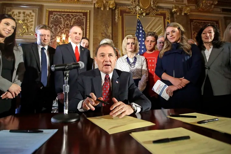 Utah Gov. Gary Herbert looks up during a ceremonial signing of a state resolution declaring pornography a public health crisis in April 2016. More than a dozen states have moved to declare pornography a public health crisis.