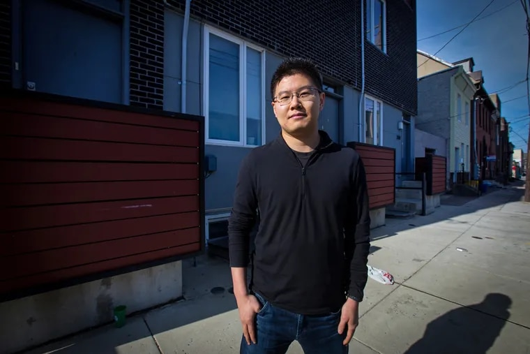Ruokai Chen, shown here in front of his Kensington home last year, won an appeal of his land value last year by arguing to a judge that his land was assessed higher than his neighbors'. The land value of his home, which has a 10-year tax abatement for new construction, increased again this year.