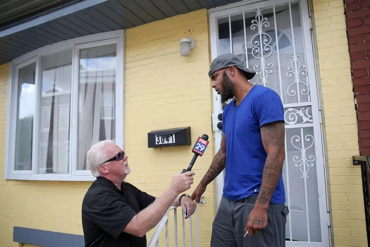 A man who identified himself as a family member, but declined to give his name, briefly talks on Thursday, Aug. 2, 2018, to reporters in front of the Port Richmond rowhouse where pit bulls, police have said, fatally mauled a toddler the day before.