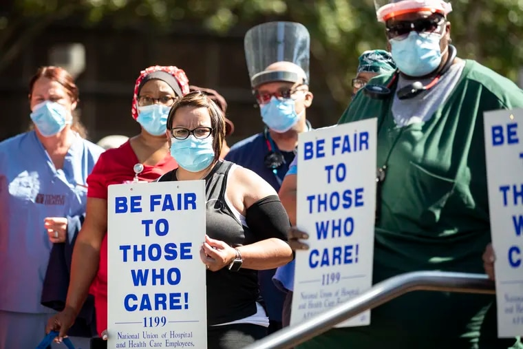 Healthcare workers and other hospital employees gathered for a press conference hosted by the National Union of Hospital and Health Care Employees (1199C) outside of Temple University Hospital in Philadelphia, Pa., July 21, 2020.
