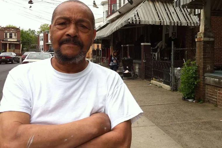Whitman Park resident Albert Harvey said he often passes drug dealers and users doing business in front of houses, many boarded up and marked with graffiti.