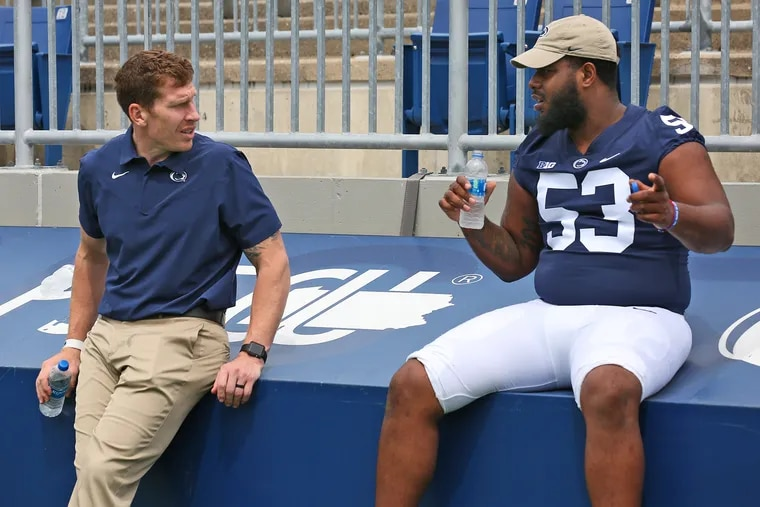 Penn State offensive line coach Phil Trautwein with left tackle Rasheed Walker.