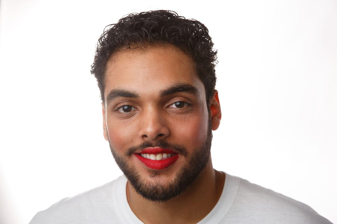 Yes, he's wearing a red lip, and he's fine with it