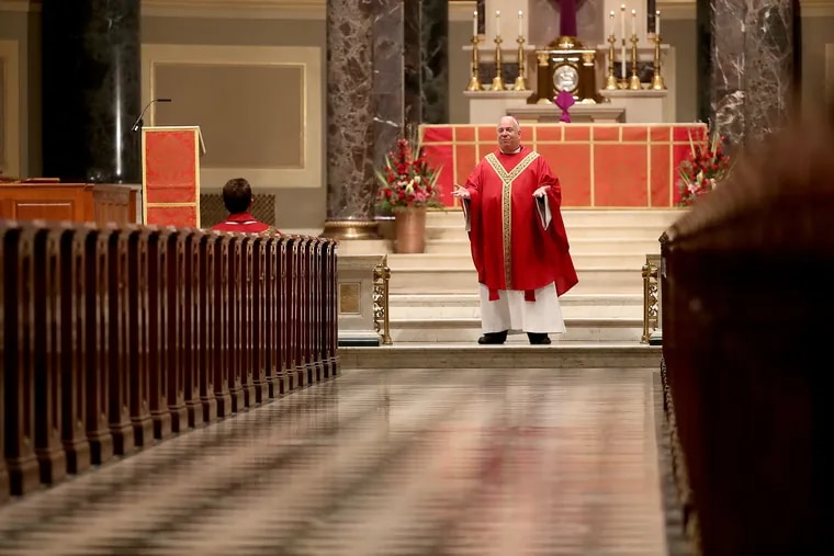 Archbishop Nelson Pérez giving his homily during Palm Sunday mass that was closed to the public at Cathedral Basilica of Saints Peter & Paul in Philadelphia on April 5.