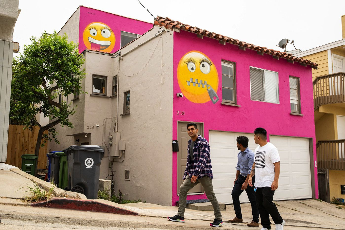 Hot-pink 'emoji house' sparks a familiar neighborhood debate about exterior paint