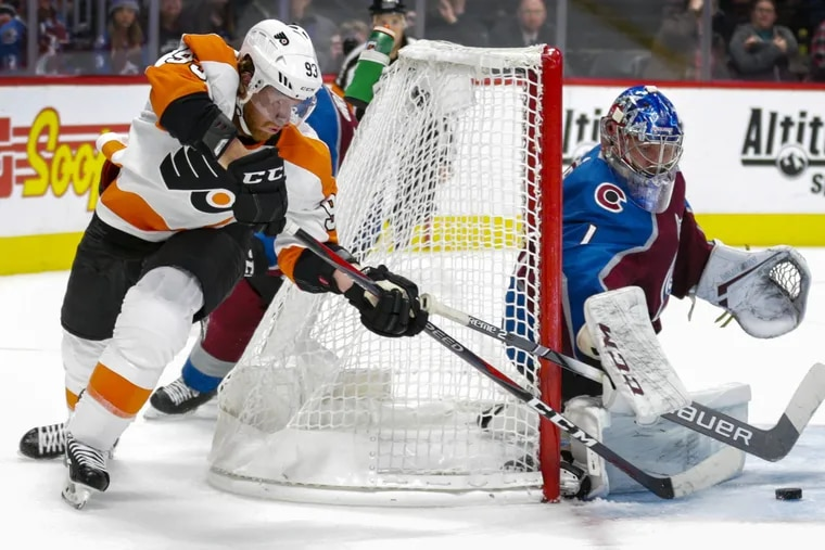 Flyers right winger Jake Voracek tries to score on a wraparound shot against Avalanche goalie Semyon Varlamov during the teams' Oct. 6 meeting in Denver. Colorado won the game, 5-2.