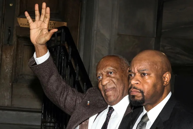 Bill Cosby waves to the public while leaving the Montgomery County Courthouse after his hearing in Norristown on Wednesday, Feb. 3, 2016.