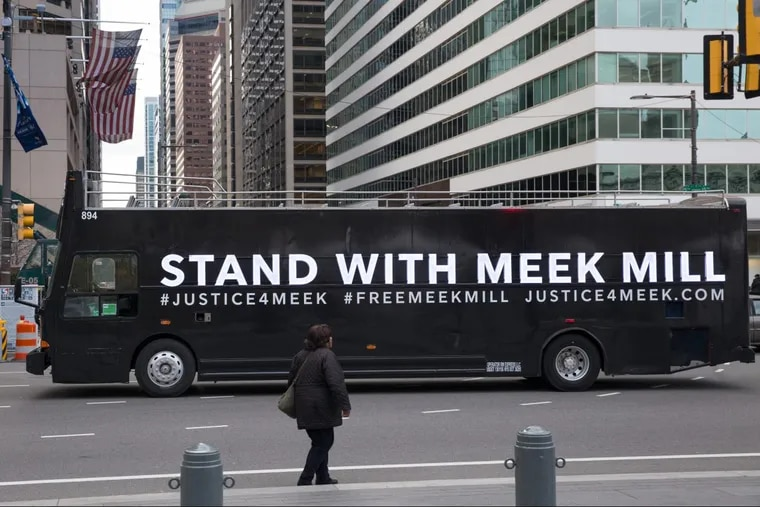 Buses with signs showing support for Meek Mill circled City Hall on Nov. 14.