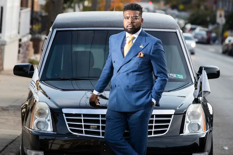 Funeral home directors in Philadelphia are staging a hearse parade on Sunday to demonstrate against gun violence.  Funeral director Escamillio D. Jones is shown in front of a hearse on Oct. 20, 2020.