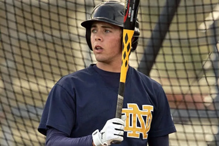 Notre Dame first baseman Kelly Dugan was the Philies' top draft pick. He signed his contract Saturday, receiving a $485,000 signing bonus and a college-tuition package.