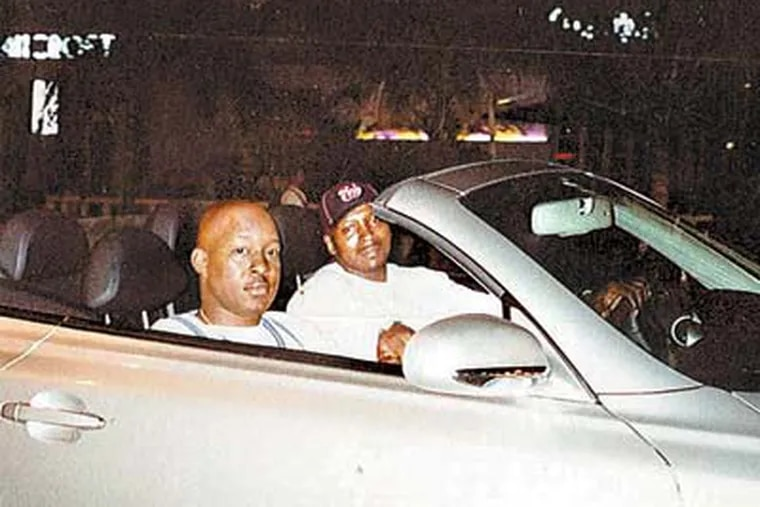 The world of Maurice Phillips (in the passenger seat) was one of fancy cars, parties and lovers. He got five life terms last week for murder and drug dealing.