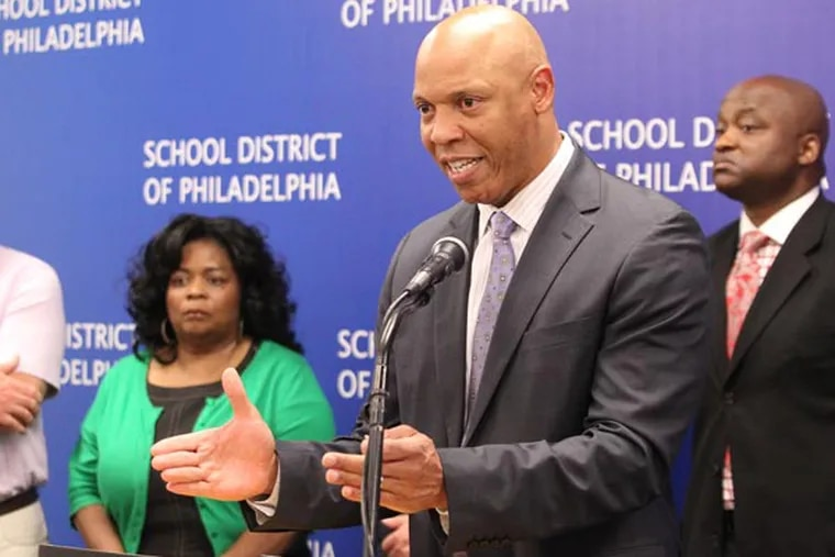 Superintendent William R. Hite Jr., center, announced o n Aug. 8, 2013, that Philadelphia schools may not open as scheduled on Sept. 9 unless the district has assurances by next week that it will receive $50 million from the city. He said the district would delay opening all 220 district schools, open just a few or operate them on half-day schedules because of the continuing financial crisis.   He is backed by high school principals.  ( CHARLES FOX / Staff Photographer )
