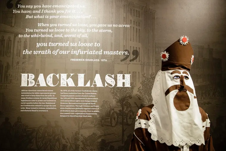"""A circa 1866 Ku Klux Klan robe and hood is displayed in the new exhibit """"Civil War and Reconstruction: The Battle for Freedom and Equality,"""" at the National Constitution Center in Philadelphia."""