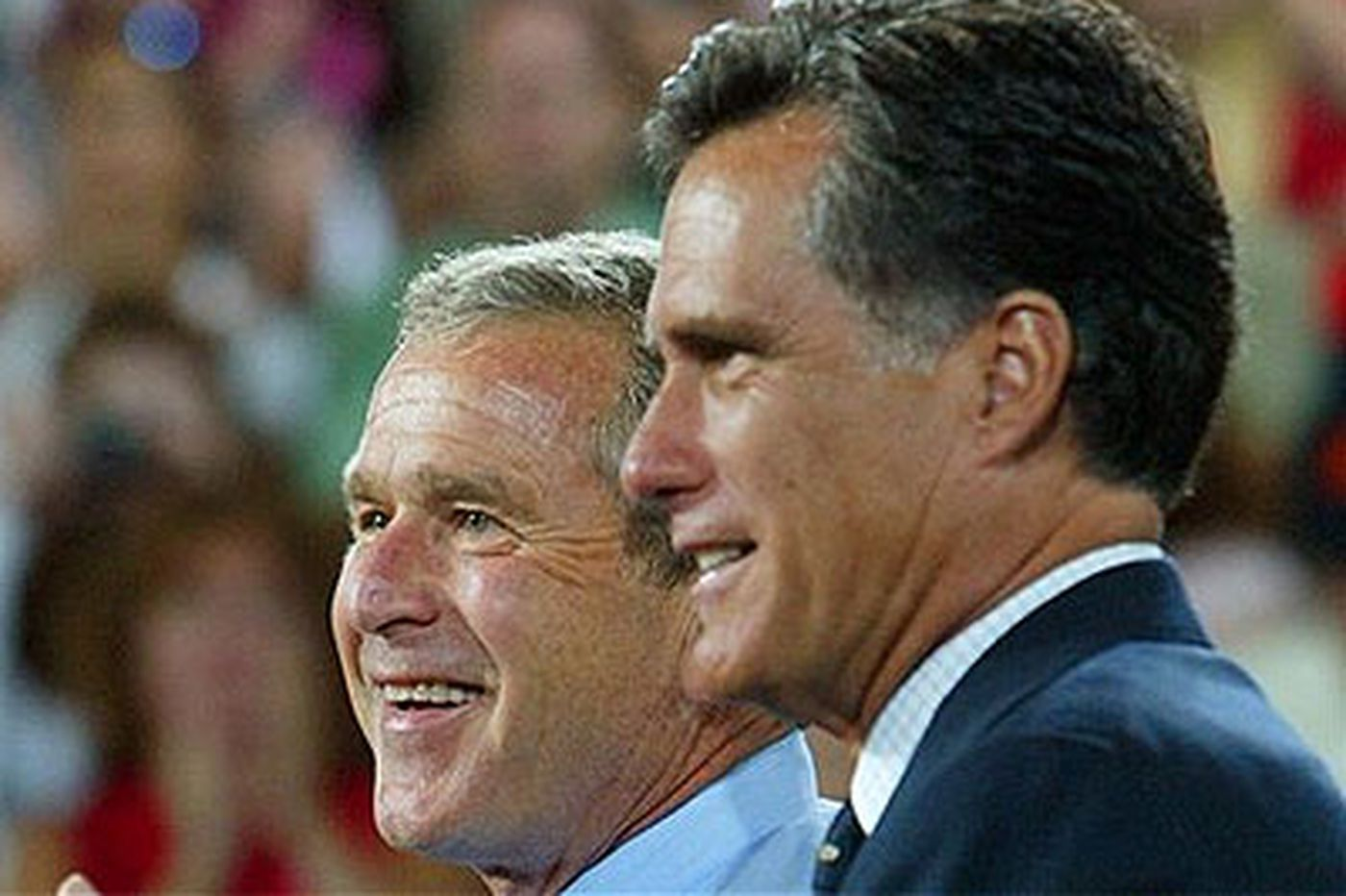 Bush says he backs Romney