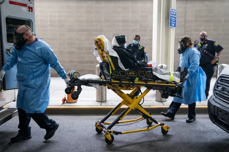 A woman is brought to an ambulance on May 26. Stroke and heart cases plummeted during the pandemic, and hospitals worry about long-term consequences for patients who delayed care.