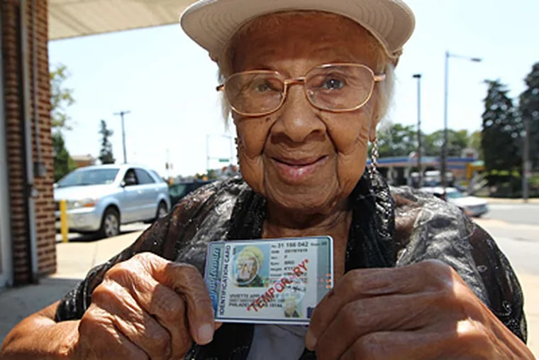 Viviette Applewhite, 93, holds up the temporary photo ID she obtained from the Pa. Department of Transportation. (MICHAEL BRYANT / Staff Photographer)