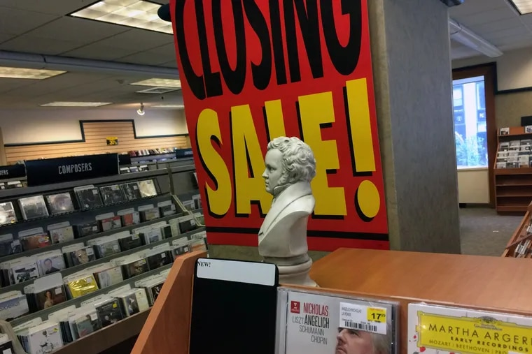 A bust of composer Franz Schubert looks out over shelves of classical recordings as banners tell of the imminent closing of F.Y.E. at Broad and Chestnut Streets, the last store in Center City to sell physical recordings of classical music.
