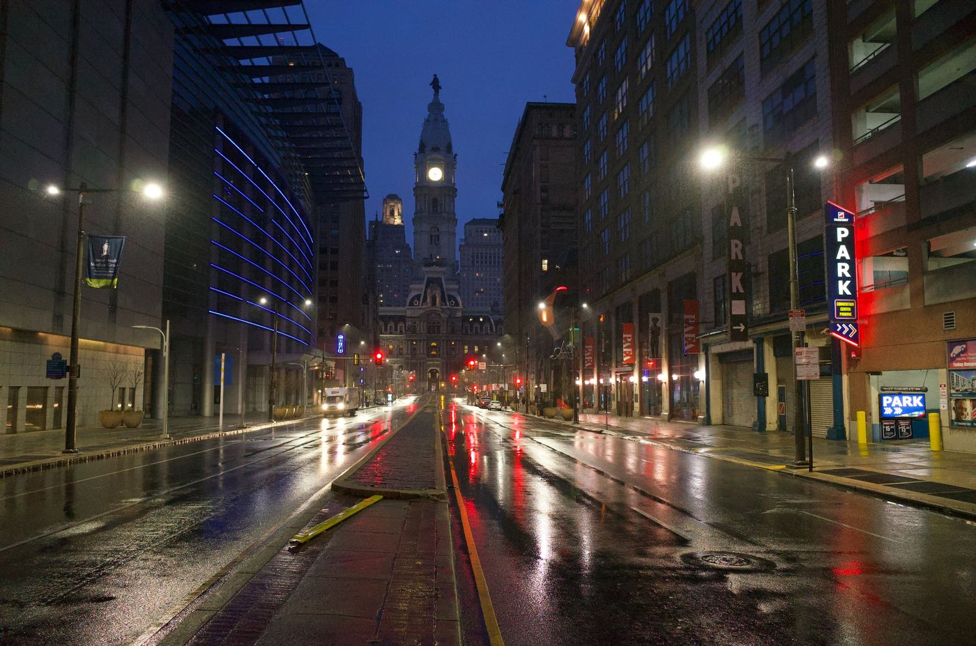 """North Broad Street is nearly deserted on a cold and rainy morning as a """"stay at home"""" order is about to go into effect in Philadelphia to counter the spread of the coronavirus."""