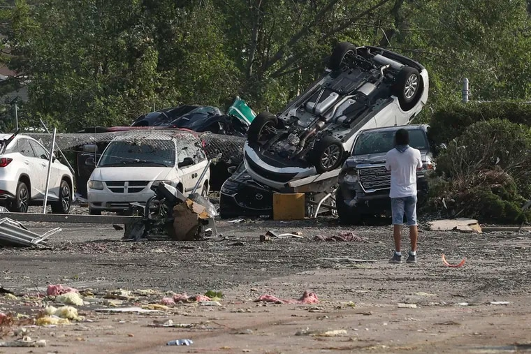 Cars are seen flipped over at the Faulkner Buick GMC Trevose after a tornado ripped through Bucks County on Thursday evening on Friday, July 30, 2021.