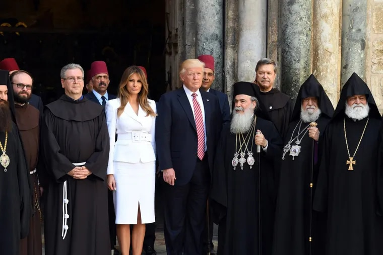 President Trump and first lady Melania Trump pose for a photo with members of the clergy during a visit to the Church of the Holy Sepulchre in Jerusalem in May.