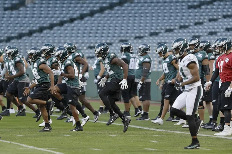 The Eagles warm up on the Angels Stadium field on Wednesday.