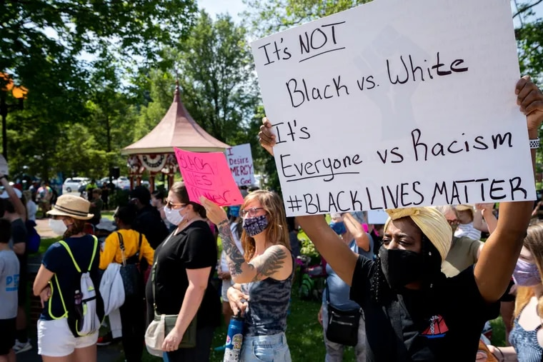 Tatiana Purcell holds a sign in support of Black Lives Matter during a protest on King St. in Shippensburg, Pa., on June 9. Similar demonstrations were held in nearby Chambersburg, prompting Franklin County District Attorney Matt Fogal write an open letter in support of the movement.