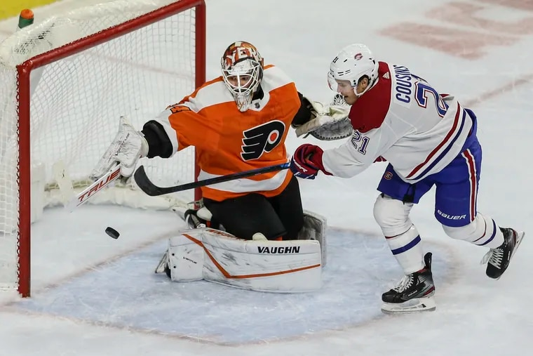 Flyers goalie Alex Lyon deflects away a shot from Montreal's Nick Cousins during Thursday's game. Lyon allowed four goals and made 36 saves in the loss.