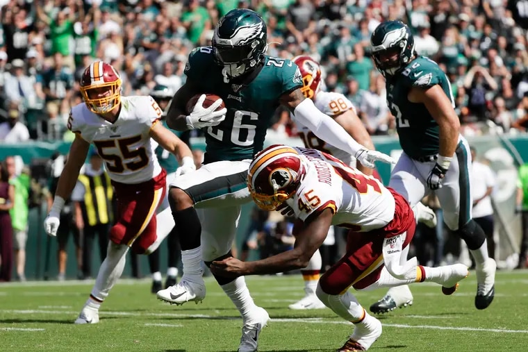 Eagles rookie Miles Sanders runs past Washington cornerback Dominique Rodgers-Cromartie in the Eagles' Week 1 win.