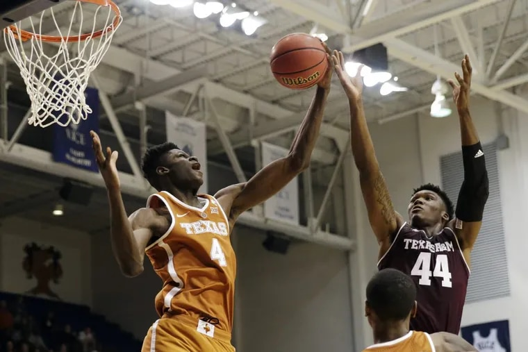 Texas forward Mohamed Bamba (left), a Westtown grad, grabs a rebound from Texas A&M forward Robert Williams in the second half of a college basketball exhibition game. Bamba had a promising debut on Friday.