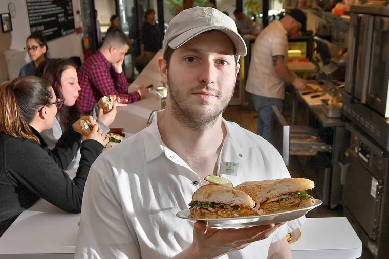 Matt Cahn, co-owner and chef at Middle Child, holds a vegan Phoagie.