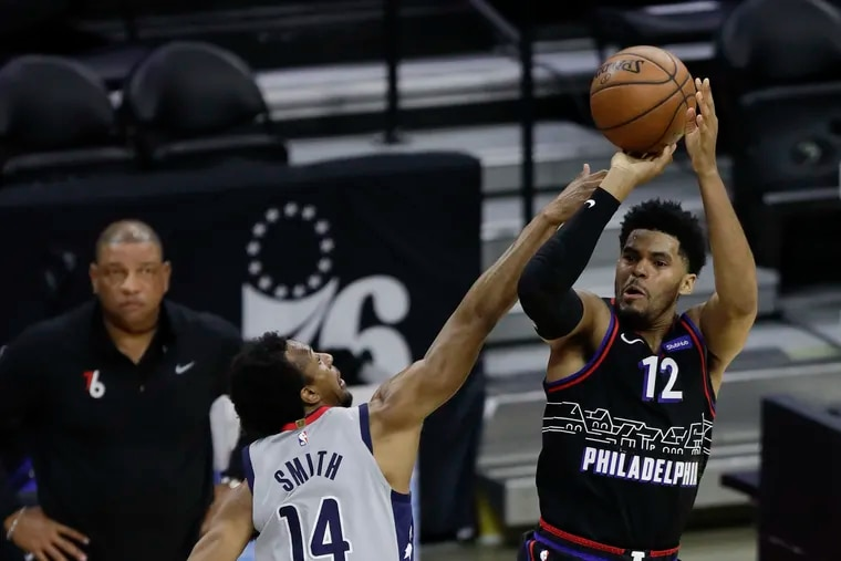 Sixers forward Tobias Harris, at 6-foot-8, shoots over the Wizards' Ish Smith, who is 6-foot. THe Sixers have enjoyed a height advantage against Washington in the Eastern Conference quarterfinals.