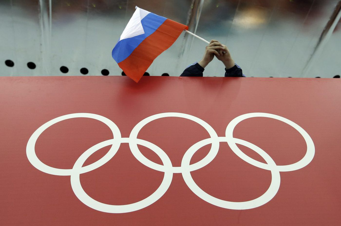 Russia banned from 2018 Olympics over state-run doping; clean athletes may compete under neutral flag