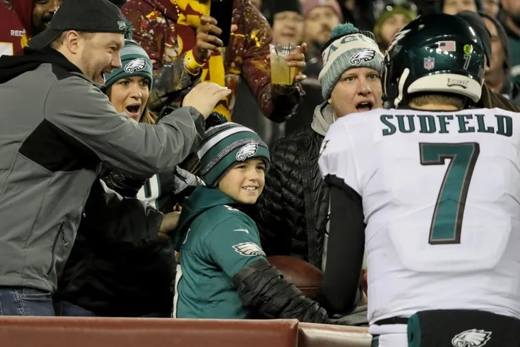 Eagles quarterback Nate Sudfeld asks for the football that Eagles wide receiver Nelson Agholor gave away to a young fan. It was Sudfeld's first touchdown pass, and he pleaded with the child to trade him. The fan got another ball.