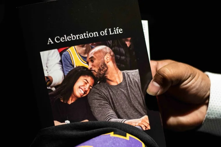 Books and shirts are given to family, friends, and fans entering Staples Center before the beginning of the Celebration of Life for Kobe and Gianna Bryant event inside Staples Center on Monday, Feb. 24th, 2020.