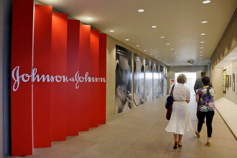 In this July 30, 2013, file photo, people walk along a corridor at the headquarters of Johnson & Johnson in New Brunswick, N.J.