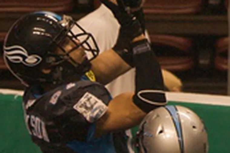 The Soul's Chris Jackson hauls in a TD over Kansas City's Jerald Brown. The Soul have lost three of their last four games.