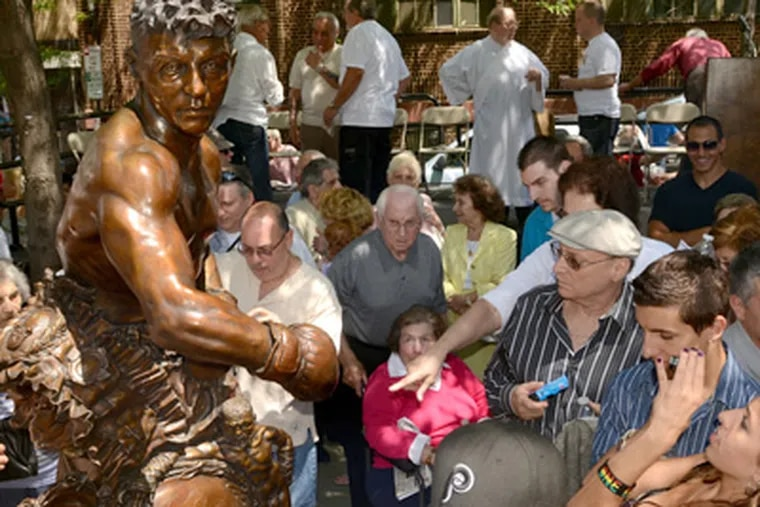 A crowd gathers around the statue of Joey Giardello after an unveiling on Saturday. (Tom Gralish / Staff Photographer)