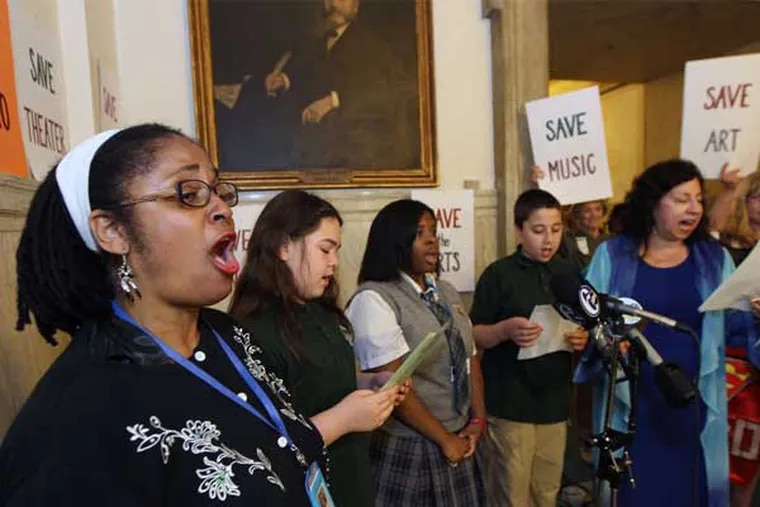 """Cynthia Lee (left), music teacher at Middle Years Alternative School, sings Mariah Carey's """"Hero"""" with her students and students from Nebinger School at City Hall."""