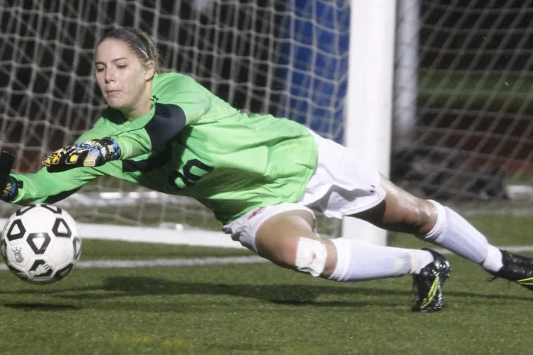 Jordynn Stallard of Washington Twp.makes a diving stop against Shawnee in the 2nd half of the semifinals of South Jersey Coaches Association Tournament in girls' soccer at Paul VI on Oct. 27, 2016. CHARLES FOX / Staff Photographer