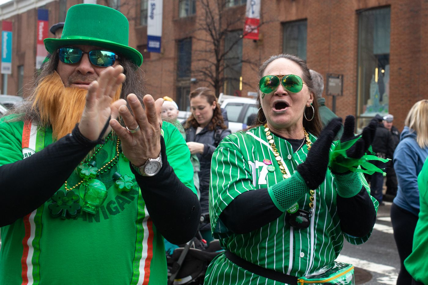 Mary Aguilar and her husband, J.R., both of Northeast Philadelphia, cheer during last year's St. Patrick's Day Parade.