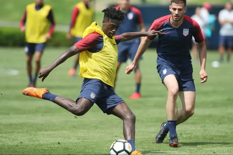 Tim Weah (center) made his debut for the United States men's national soccer team in March, and is rising at French club Paris Saint-Germain.