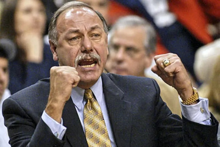 Former Sixers coach Chris Ford directs the team in 2004. (AP File Photo / George Widman)