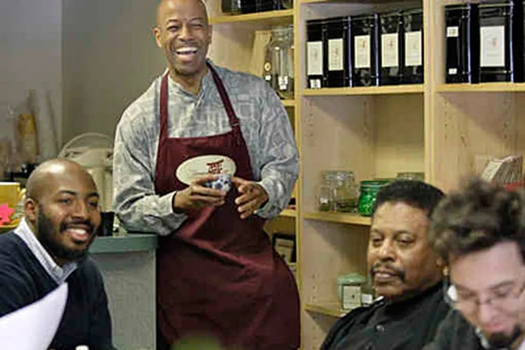 Tea Country owner Howard James (standing) with Joseph Moore, James Vance, and Evan Draber, tea club members. James and co-investors opened the shop in 2004. (Elizabeth Robertson / Staff)